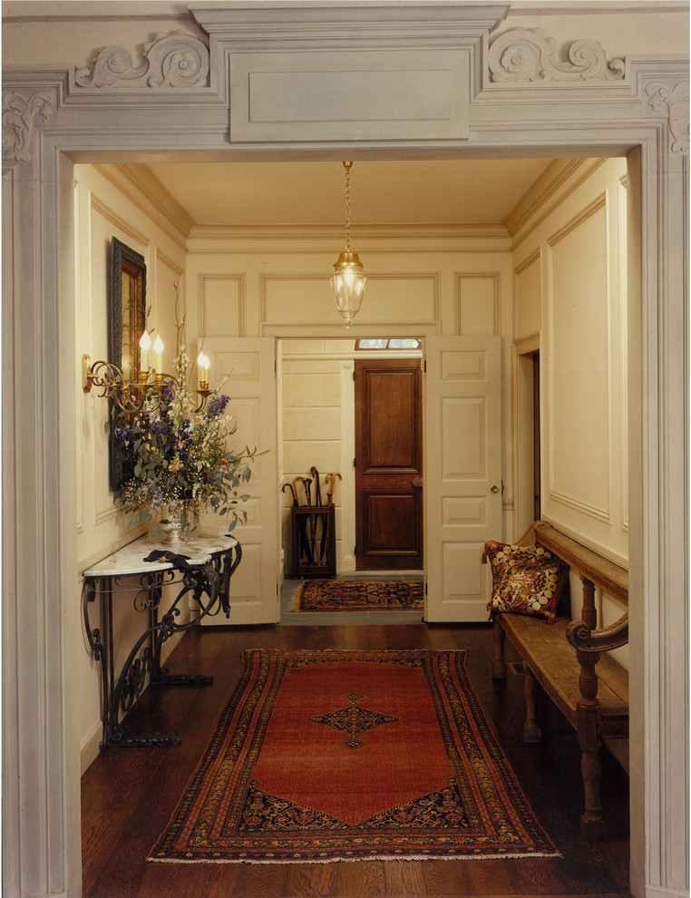 Example of a mountain style vestibule design in Boston with a dark wood front door