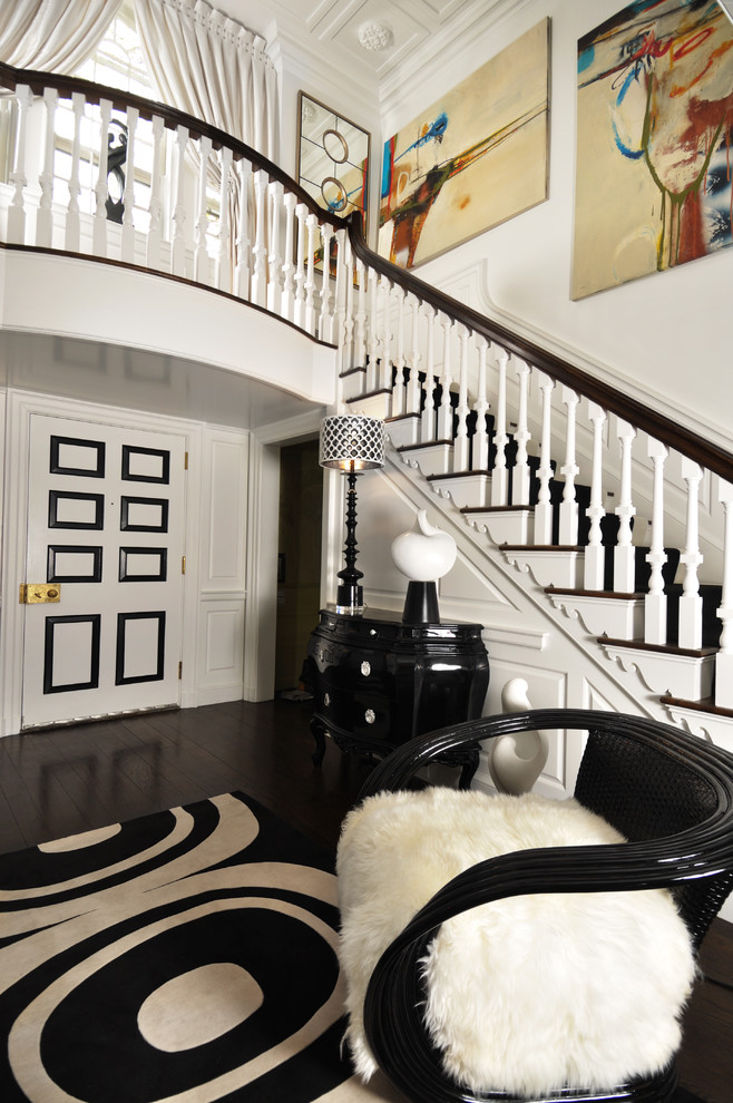 Example of a large trendy dark wood floor entryway design in Las Vegas with white walls
