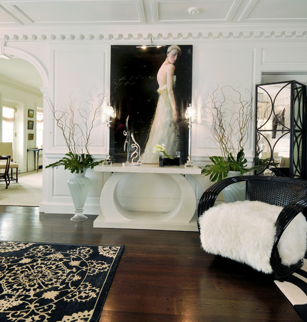 Example of a huge trendy dark wood floor foyer design in Miami with white walls