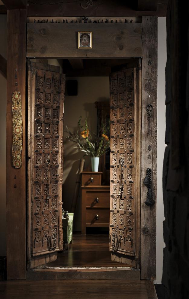 Entryway - entryway idea in Chicago with a brown front door