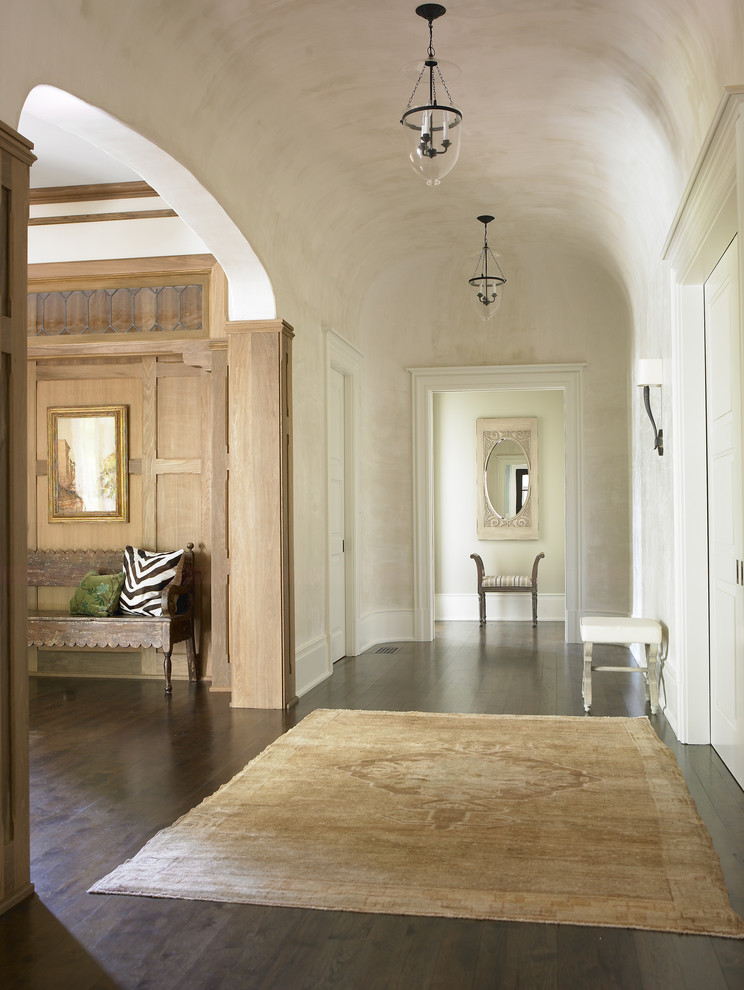 Inspiration for a large timeless dark wood floor foyer remodel in Atlanta with beige walls