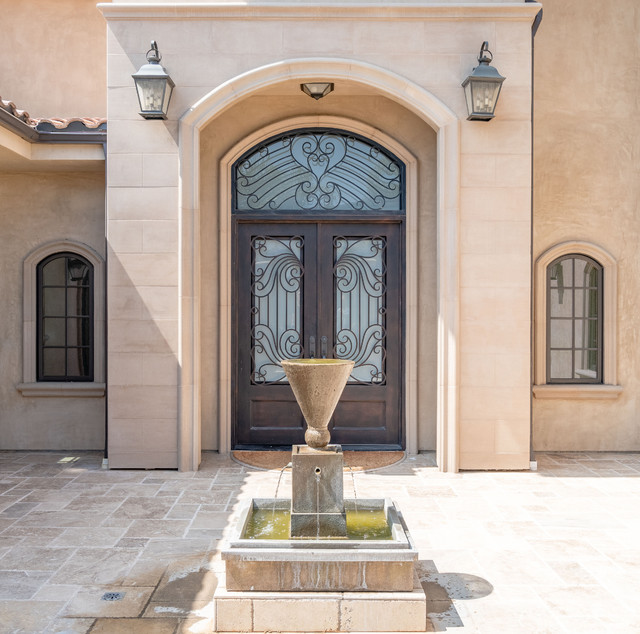 Tuscan entryway photo in Los Angeles