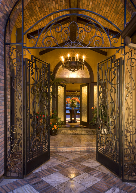 Entry Courtyard with hand forged Iron work sets the stage! mediterranean-entry