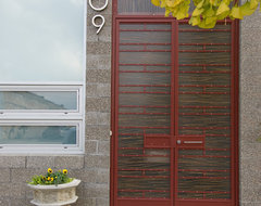 entry detail - decorative unit masonry, resin panels and custom ironwork contemporary entry
