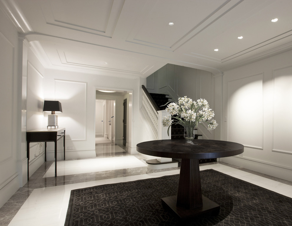 Foyer - contemporary marble floor foyer idea in Chicago with white walls