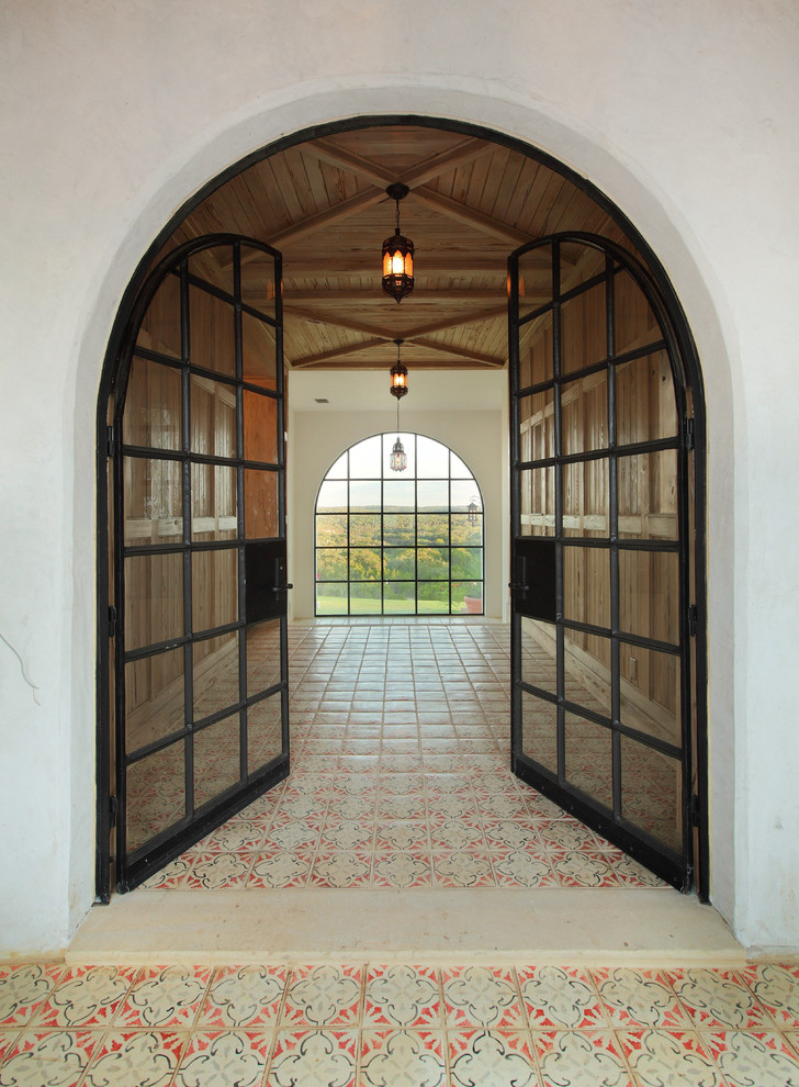Inspiration for a mediterranean ceramic tile double front door remodel in Austin with a glass front door