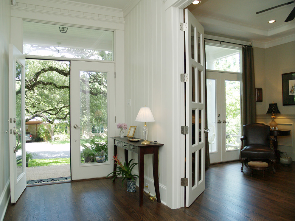 Inspiration for a timeless entryway remodel in Austin with white walls