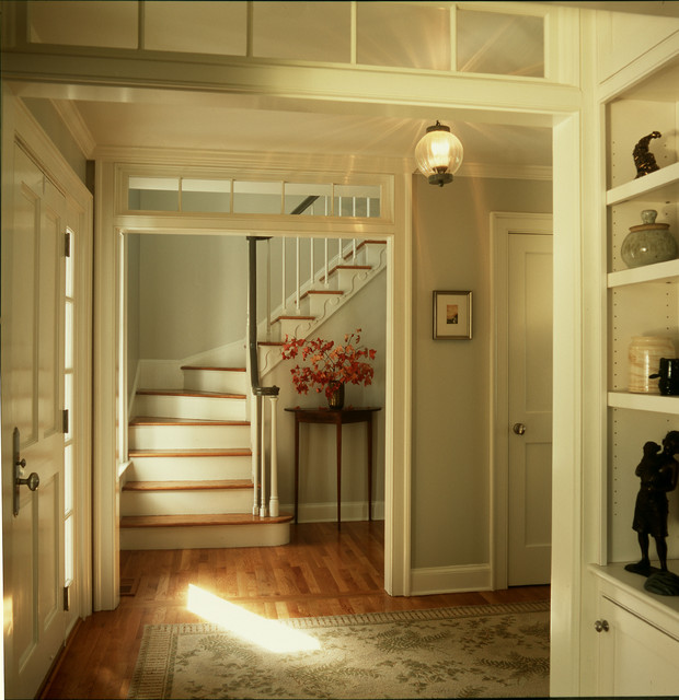 Entry foyer with transoms over openings traditional for Transom windows
