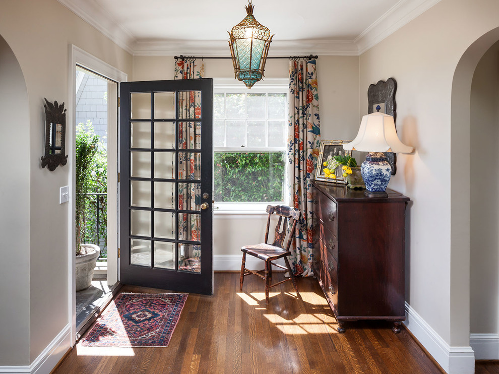Inspiration for a timeless dark wood floor entryway remodel in Portland with beige walls and a glass front door