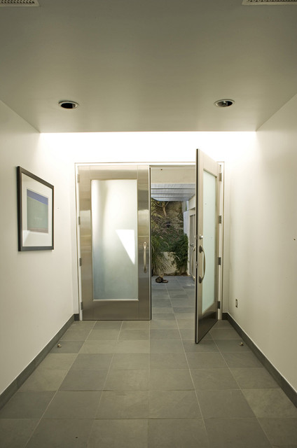 Entry hall to contemporary home by mgs architecture for Hall entrance door designs