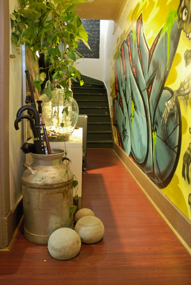 Inspiration for an eclectic entry hall remodel in Vancouver with yellow walls