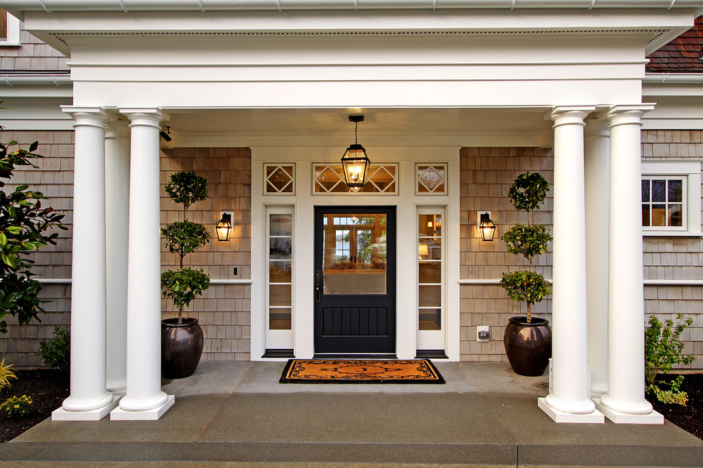 Ornate entryway photo in Seattle with a black front door