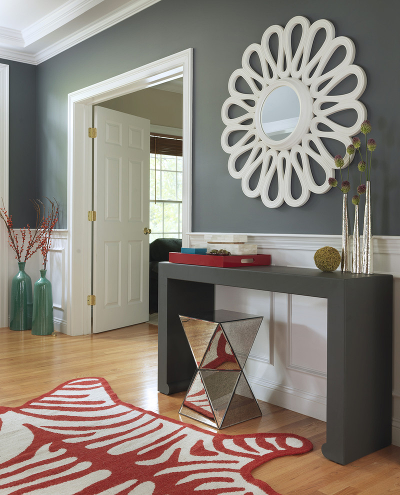 Example of a transitional light wood floor entryway design in Boston with gray walls