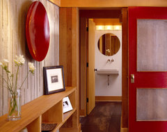 Entry with tile floors, board formed concrete and red door contemporary-entry