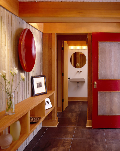 Entry with tile floors, board formed concrete and red door modern entry