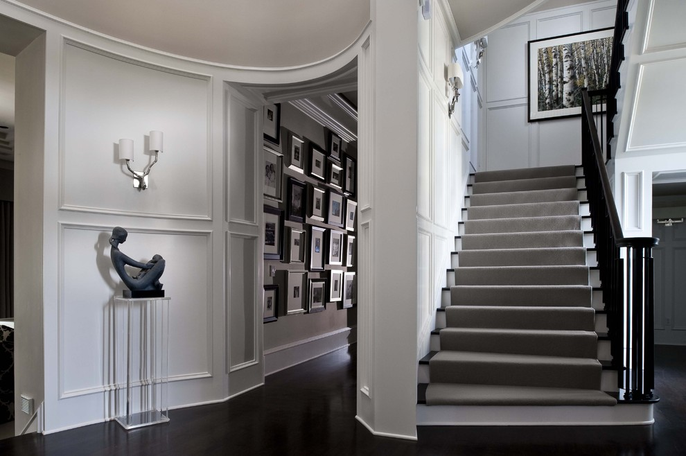Example of a huge classic dark wood floor foyer design in Orlando with white walls