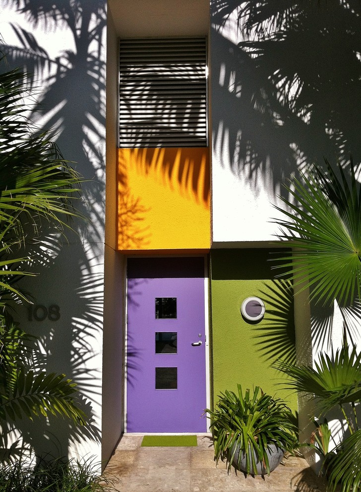 Example of a trendy entryway design in Miami with a purple front door
