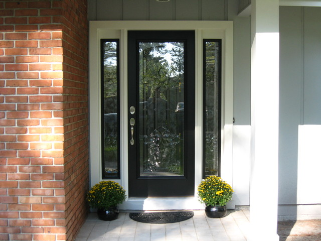 Photo Of A Traditional Front Door In Miami With Single And Black