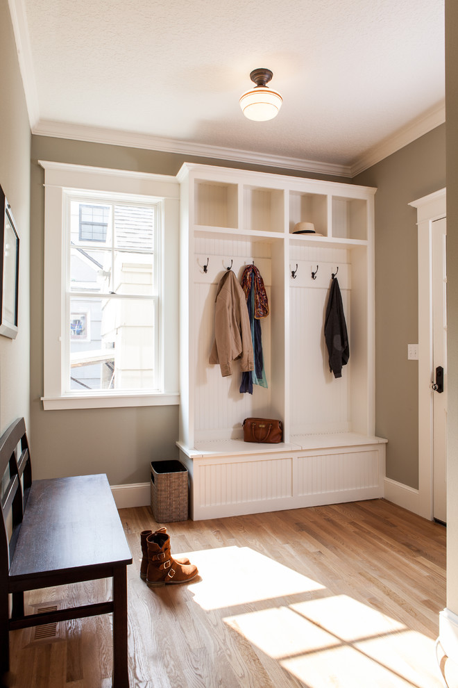 Elegant mudroom photo in Portland with a white front door and gray walls