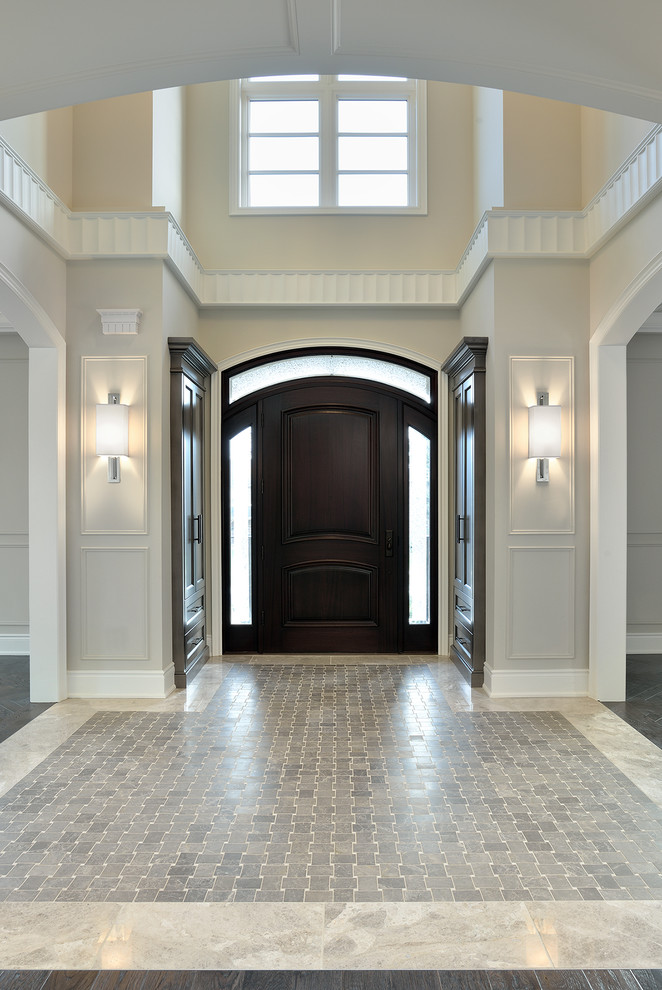 Entryway - traditional gray floor entryway idea in Toronto with a dark wood front door