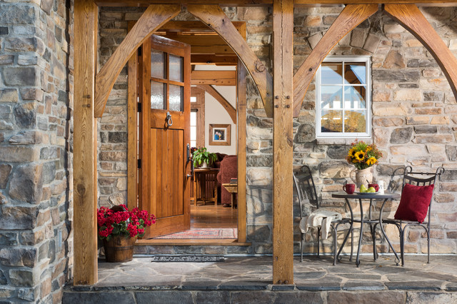european inspired timber frame home covered entry porch traditional entry