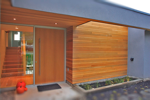inspiration for a modern single front door remodel in vancouver with a medium wood front door