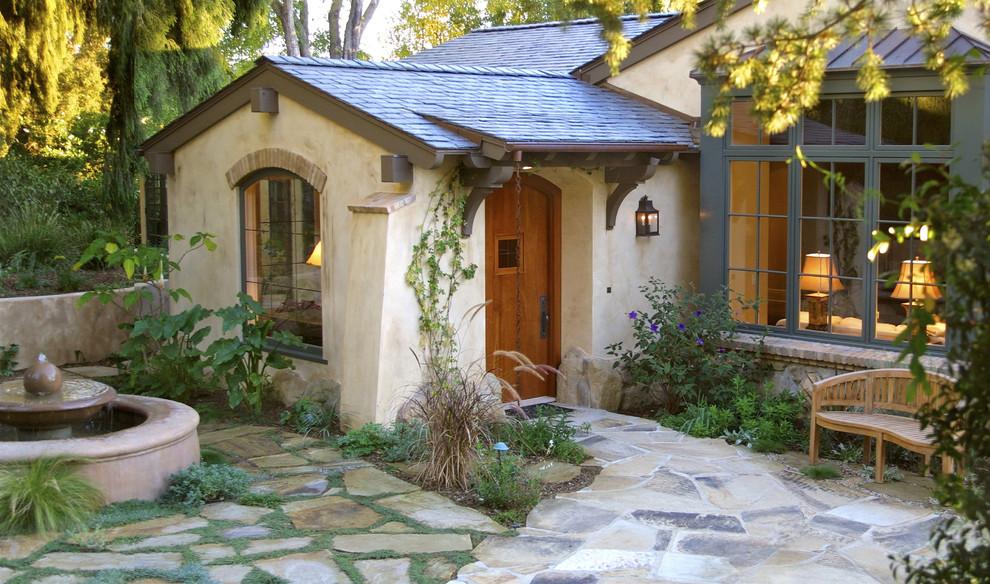 Single front door - traditional single front door idea in Santa Barbara with a medium wood front door