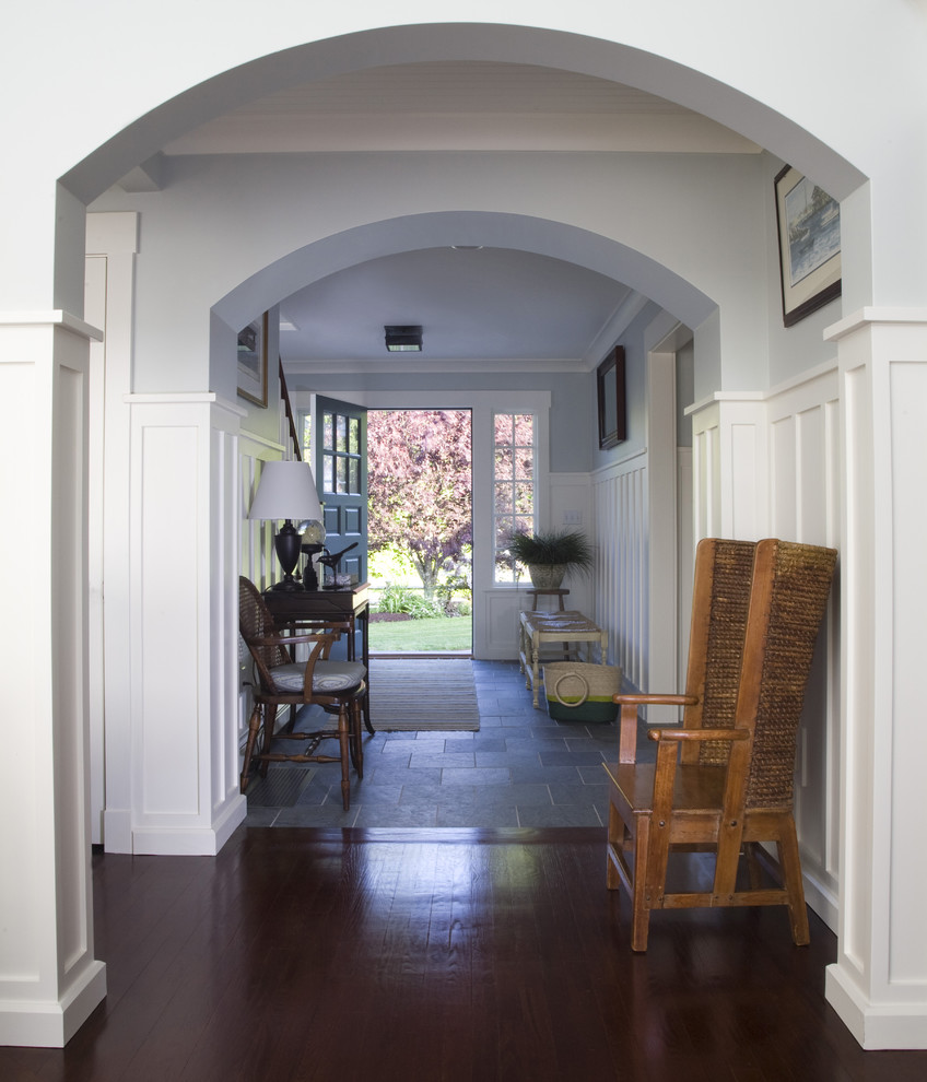 Example of a beach style dark wood floor entryway design in Providence