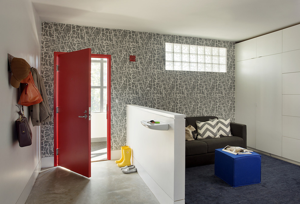 Inspiration for a mid-sized contemporary concrete floor entryway remodel in Boston with multicolored walls and a red front door