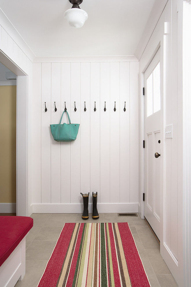 Large cottage ceramic floor and gray floor entryway photo in Minneapolis with white walls