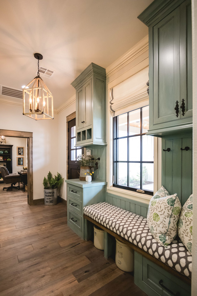 Inspiration for a country medium tone wood floor entryway remodel in Oklahoma City with beige walls and a dark wood front door