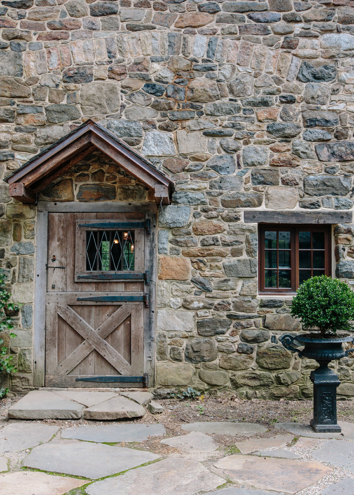 Example of a farmhouse dutch front door design in New York