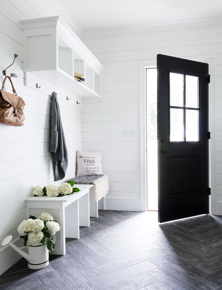 Cottage entryway photo in New York with white walls and a black front door