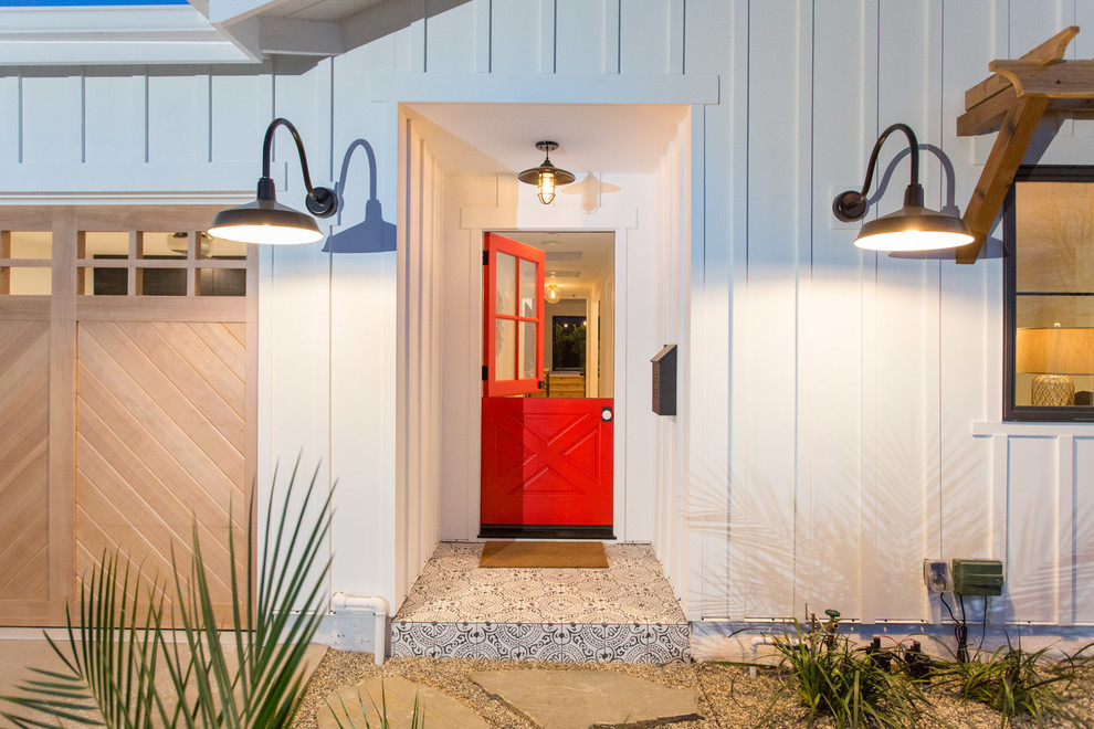 Inspiration for a mid-sized country entryway remodel in Los Angeles with a red front door