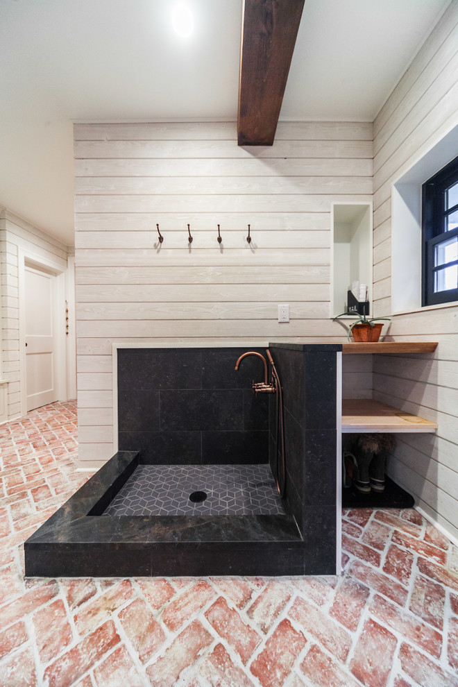Large cottage brick floor and multicolored floor entryway photo in Philadelphia with white walls and a gray front door