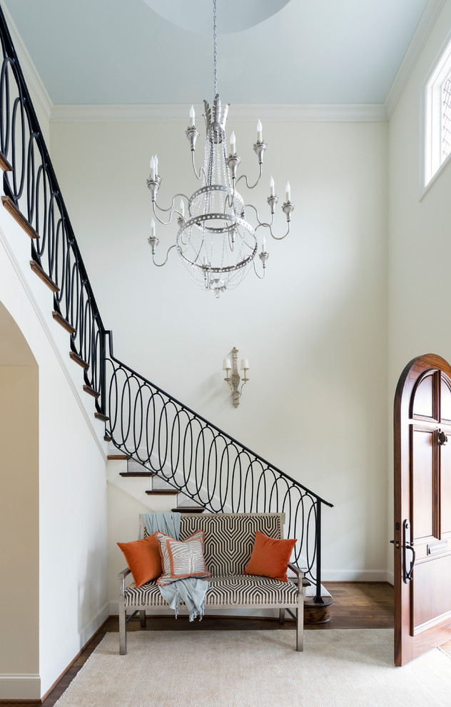 Elegant medium tone wood floor and brown floor entryway photo in Dallas with beige walls and a medium wood front door