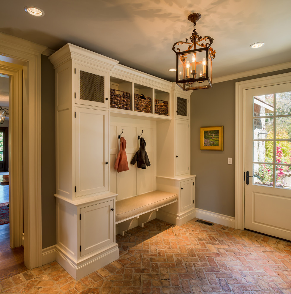Inspiration for a large timeless brick floor entryway remodel in Philadelphia with gray walls and a white front door