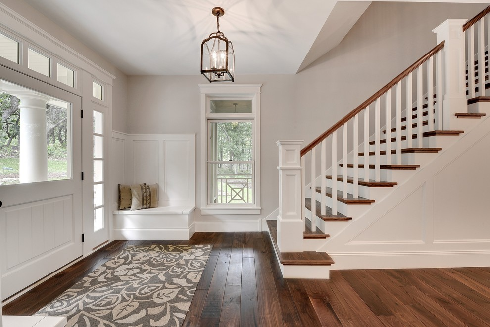 Mid-sized transitional dark wood floor and brown floor entryway photo in Minneapolis with a white front door and gray walls
