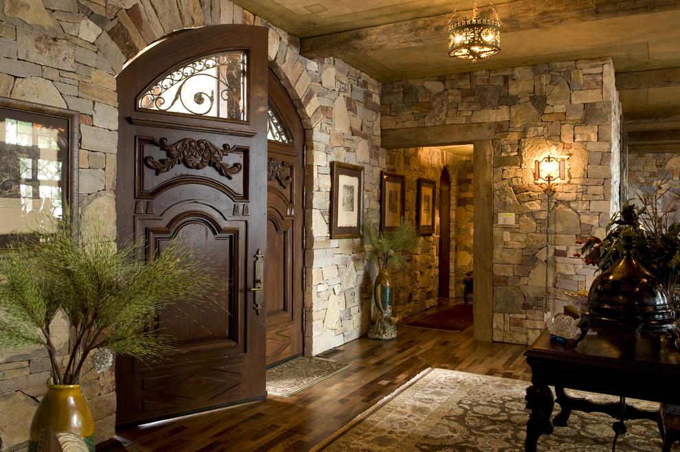 Mountain style double front door photo in Minneapolis with a dark wood front door