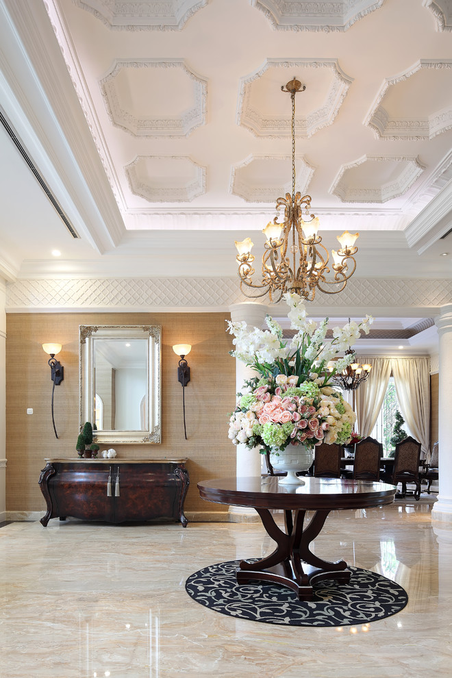 Ornate marble floor foyer photo in Other with beige walls
