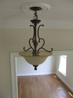 Foyer Light Fixture In Two Story Traditional Home