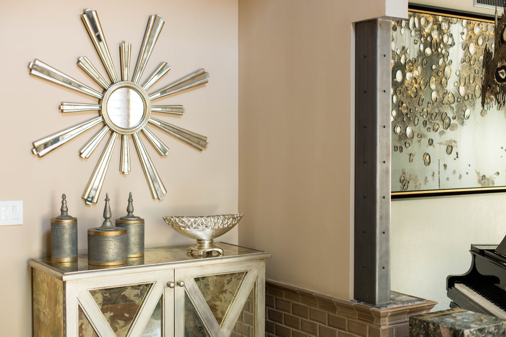 Entryway - mid-sized eclectic travertine floor entryway idea in Los Angeles with beige walls and a medium wood front door