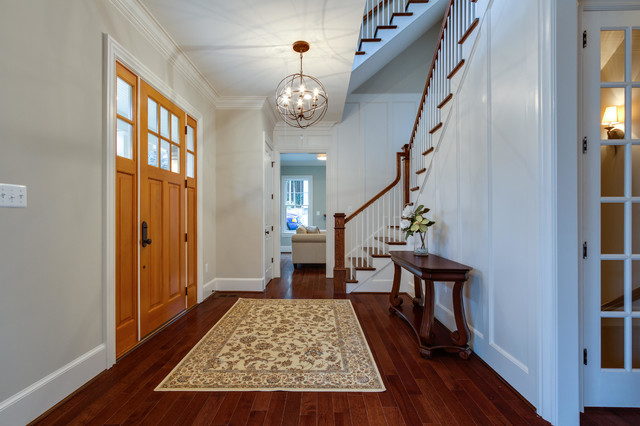 Foyer with curved staircase traditional-entry
