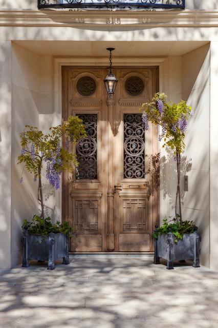 Tuscan entryway photo in San Francisco with a medium wood front door