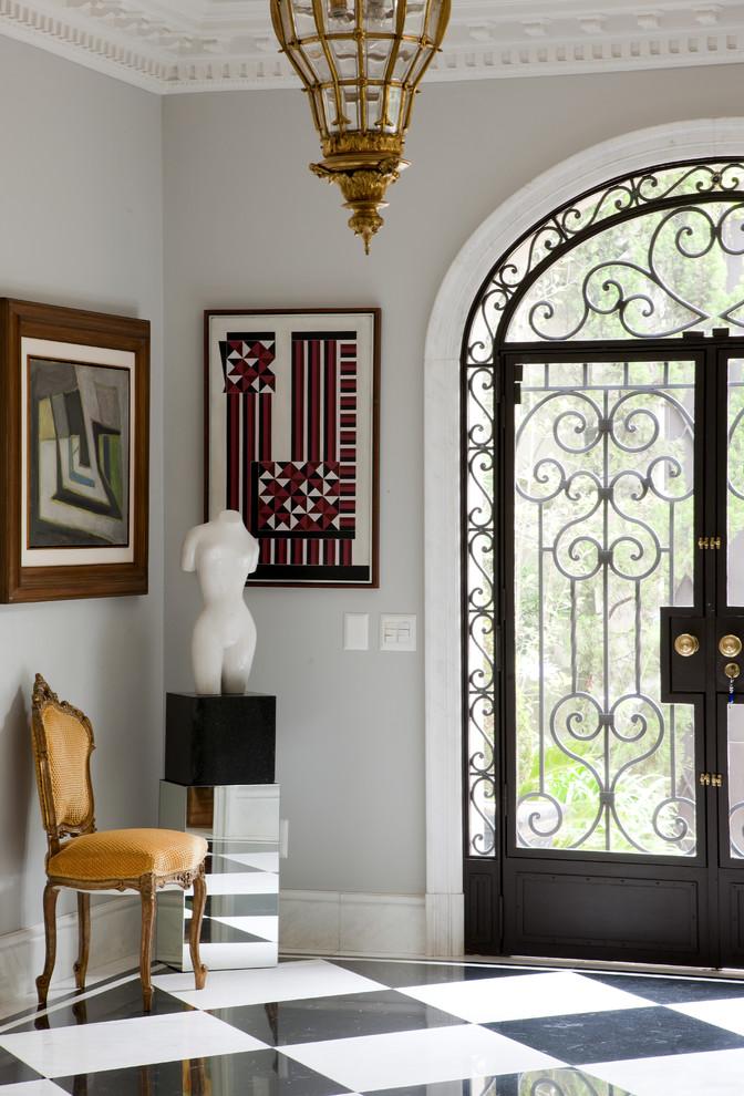 Double front door - traditional multicolored floor double front door idea in Other with a glass front door