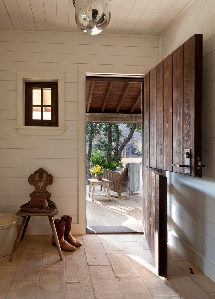 Cottage dutch front door photo in Austin with white walls and a medium wood front door
