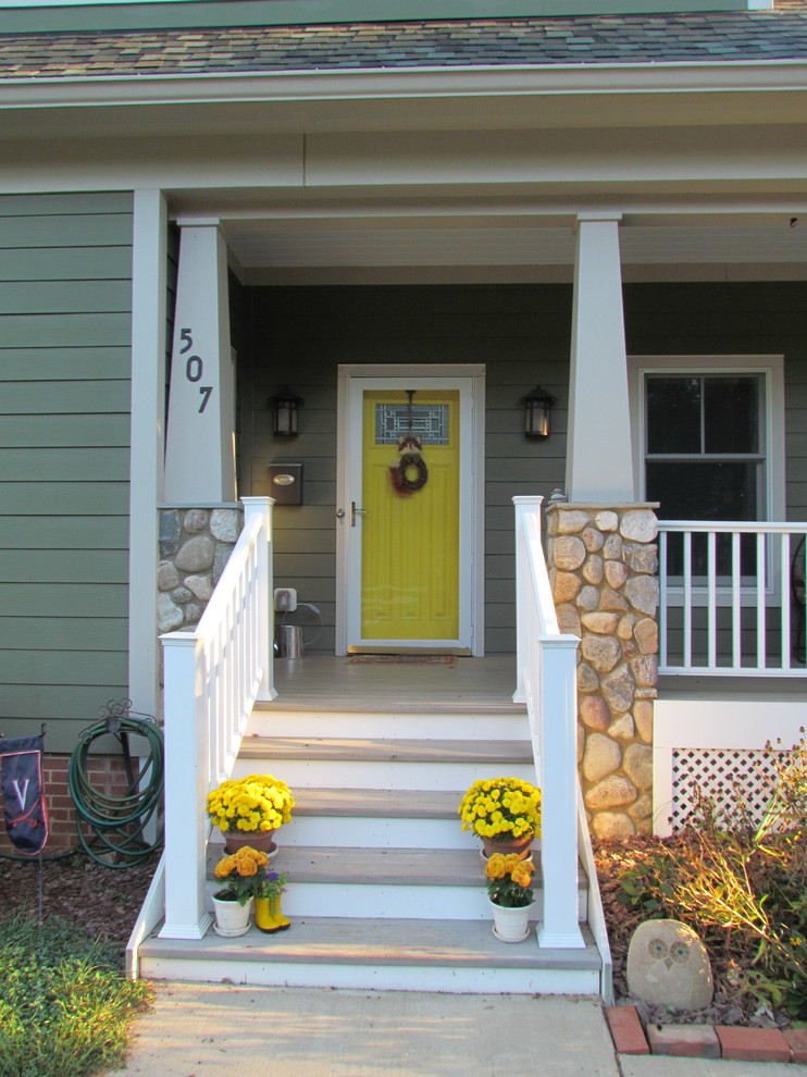 Inspiration for a mid-sized craftsman painted wood floor and gray floor entryway remodel in DC Metro with green walls and a yellow front door