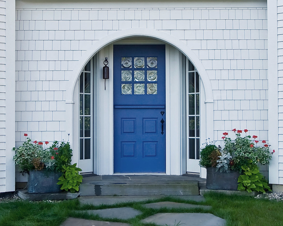Inspiration for a timeless entryway remodel in Chicago with a blue front door