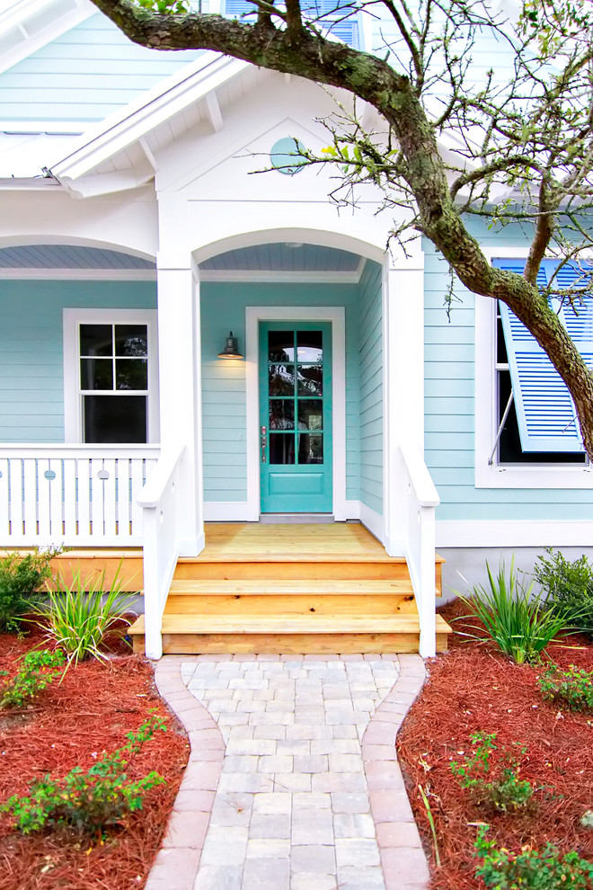 Beach style single front door photo in Jacksonville