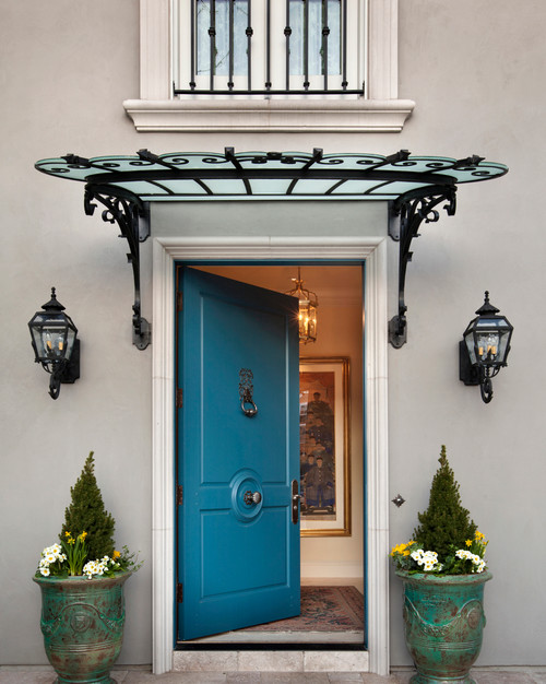 I love the iron & glass awning over front door. Where can I find this?